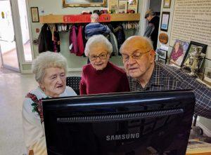 Museum visitors watching the kiosk slideshow